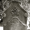 Headstone with clasping-hands symbol at Trinity Church Cemetery & Mausoleum, NYC.