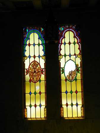 Angeles Mausoleum stained glass 2 - you can see where a rock was thrown through the right window from outside