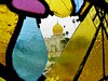 This is my art shot. Looking at another mausoleum through a broken stained glass window in the Flowers Mausoleum