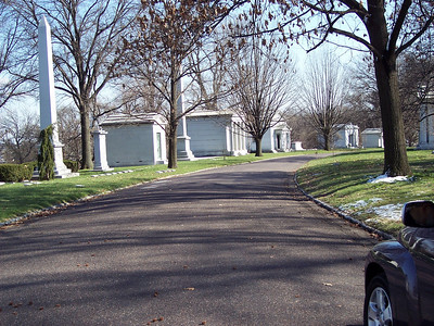 """I thought of this street as """"Mausoleum Row""""--one huge structure after another, each more elaborate than the next.  It seems that """"keeping up with the Joneses"""" is a valid concept for the afterlife as well as the here and now."""