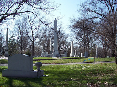 The monument to the most famous resident of Bellefontaine, William Clark of Lewis and Clark fame.  The memorial consists of the tall obelisk flanked by pillars with sculpture and inscriptions, and a bust of Clark.  Photographed from across the road so I could get it all in.