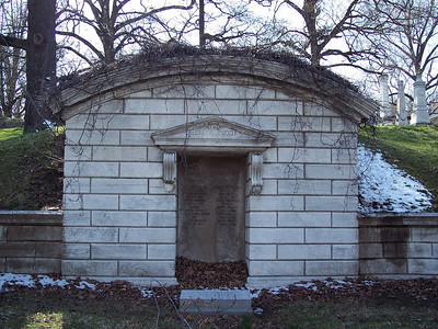 There were a number of these tombs built into the hillside.  I thought they were interesting and beautiful, with the vines growing over them and the dead leaves on the door sill.