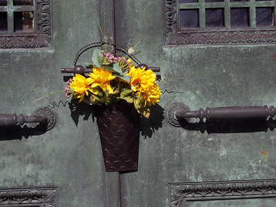 """This little bouquet of artifical flowers was hanging on the door of one of the tombs in """"Mausoleum Row."""""""