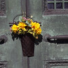 "This little bouquet of artifical flowers was hanging on the door of one of the tombs in ""Mausoleum Row."""