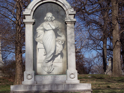 A well-known monument at Bellefontaine. Mr. Luyties was a prominent St. Louis druggist, who traveled to Italy and fell for this pretty young thing, a sculptor's model.  She resisted his blandishments, so he brought the marble her back to St. Louis and she eventually ended up adorning his tomb.  To prevent her from suffering weather damage, a glass door was fitted to the front of her alcove.  It isn't easy to see in this picture but it is there.