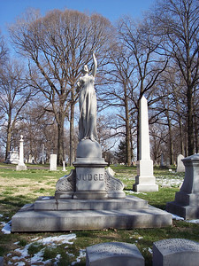 """A sculpture from what I think of as the """"soft core"""" school of cemetery art--nubile young lady in clingy robes.  The grave itself seems more like a pretext for showing off the beautiful girl than an expression of grief.  But I believe she's a popular stop on tours of the cemetery."""