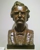 """#58 - """"Mark Twain"""" by Gladys Lewis Bush<br /> When Mark Twain's daughter, Madame Clara Clemens Gabrilowitsch, first saw this bronze portrait bust of her father, she gazed awe-struck for a moment, then whispered, """"It is a work of genius, a true  masterpiece."""" Later, in a letter to the sculptor, Mrs. Gabrilowitsch wrote: """"It is a veritable miracle that in this earthly medium you have succeeded in revealing the innermost soul of Mark Twain. The salient characteristics of his personality have been captured with amazing perfection - likewise, his intelligence, a certain majesty of sincerity that was his, and even a touch of his humor."""" The artist has captured in her work not only the humor, but also the passionate sincerity of Mark Twain. In the poise of the head, the direct gaze, we catch the interest in life and humanity which made his appeal universal. Gladys Lewis-Bush, of Los Angeles, created the statue expressly for Forest Lawn on commission from Dr. Hubert Eaton, Chairman of the Board. She worked from photographs of Mark Twain, supplied by Mrs. Gabrilowitsch."""
