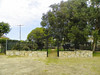The cemetery is set against the north edge of the property