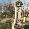 The Hucke gravestone is a Woodmen of the World (W.O.W) style with many tree limbs and logs for the base.  The large urn on top represents immortality, death of the body and its return to the final resting place.  Elmwood Cemetery, Kansas City, Missouri Dec. 9, 2001