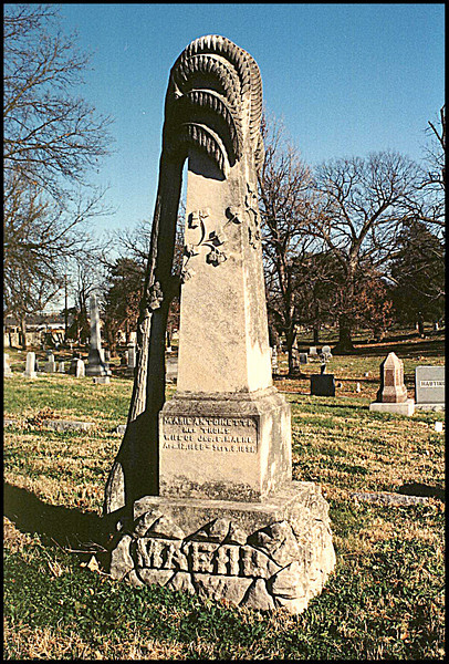 The Maehl obelisk was a very unusual stone, for me, not ever seeing one with a clinging palm tree like this. A leaning tree trunk symbolizes a short interrupted life, and mourning which this looks like.  There is ivy around the stone also, indicating fidelity, attachment, undying affection and eternal life.   Elmwood Cemetery, Kansas City, Missouri  Dec. 9, 2001