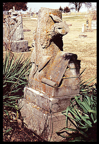 W.O.W., Woodmen of the World, tombstone shaped like a tree trunk.  This is a side view of the last picture. Hillcrest Cemetery, Gallatin, MO., April 3, 2002.  (scanned from photograph)