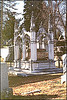 A gothic style framework around a sarcophagus, which is for a body buried above ground.  Mt Mora Cemetery Kansas City, Missouri Dec.2, 2001