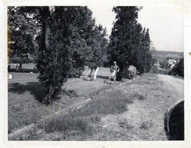 Grass Cutting in the Old City Cemetery (00490)