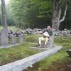 Bill Driscoll in John Ross's chair, Phillips Cemetery, September 3, 2015.