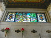 Unclaimed cremated remains are stored behind the stained glass above the crypts.