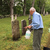 Bruce Hill spraying on water, Cutter Cemetery, August 12, 2017.