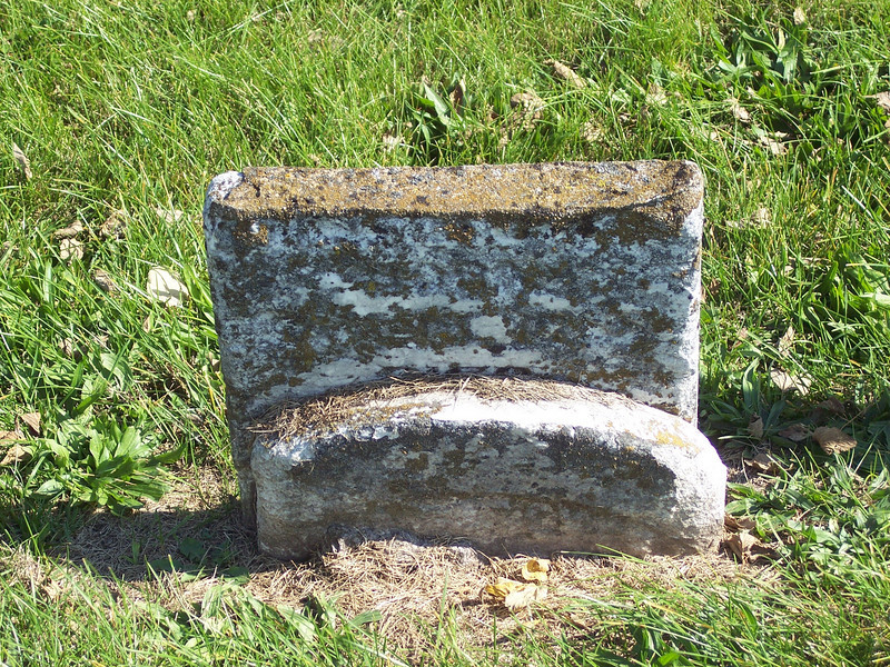 Tyrone Cemetery, Talleyrand, Iowa.  An ancestor's grave stone, although it's broken and illegible.