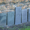 Headstones against a wall