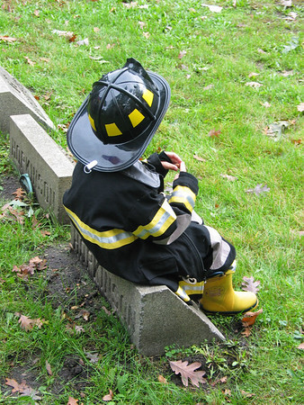 Kid dressed as firefighter