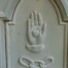 A white bronze Oddfellows emblem