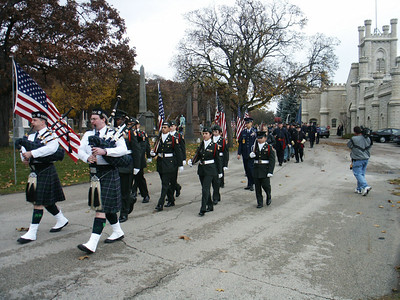 The Emerald Society Bagpipers and the Lane Tech ROTC color guard.