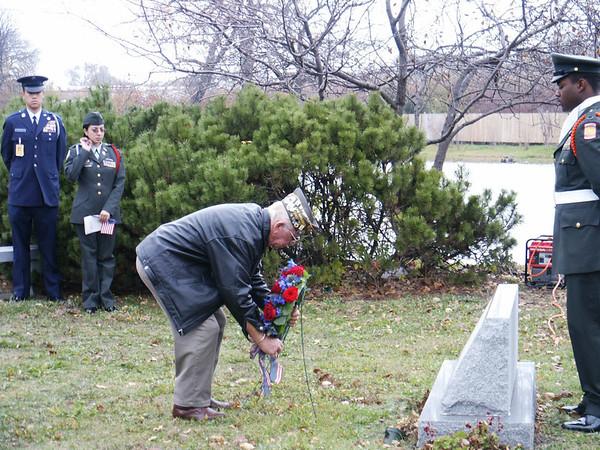 Commander Danny Wenserski laying the wreath