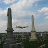 PIA airplane over cemetery
