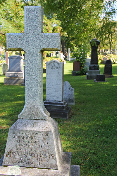 White Granite Cross Tombstone in Cemetery