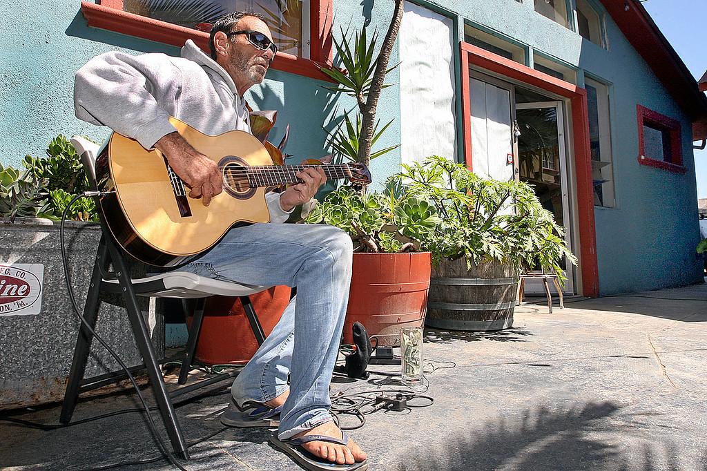 . Michael David plays jazz on the patio of Cemitas in Davenport.  (Dan Coyro -- Santa Cruz Sentinel)