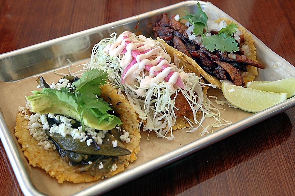 . Trio of tacas includes the vegetarian rajas poblano, pescado, and al pastor made with spit-roasted pork. (Dan Coyro -- Santa Cruz Sentinel)