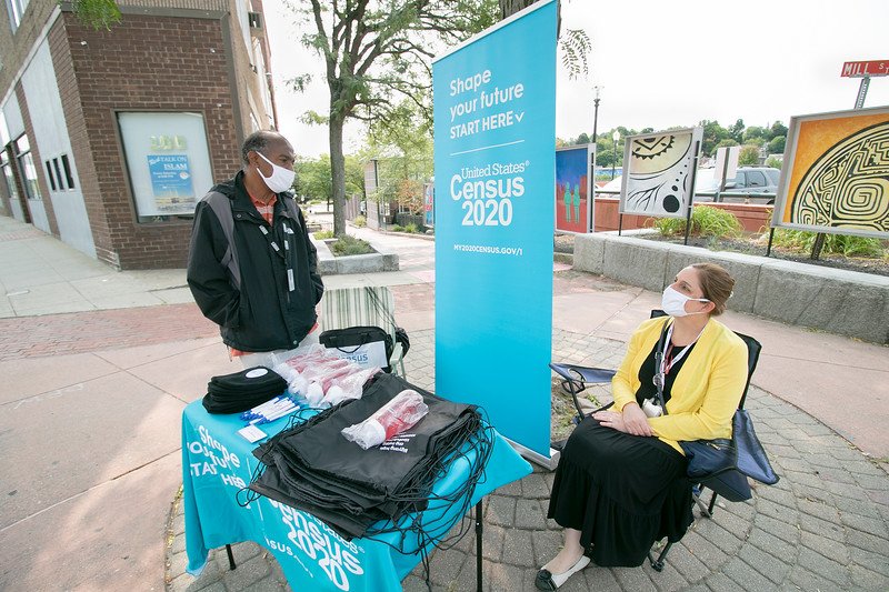 Two census workers had a table on Main Street in Fitchburg on Tuesday collecting info for the Mobile Questionaire Assistance Site. SENTINEL & ENTERPRISE/JOHN LOVE