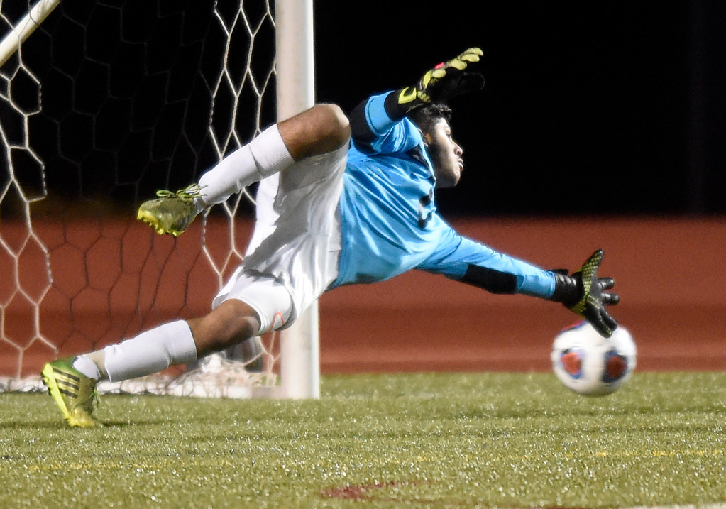 . Niwot High School goalkeeper Mario Munoz misses a save during a CHSAA 4A State Semifinal game against Centaurus on Wednesday at Legacy Stadium in Aurora. Centaurus won the game 2-0. For more photos of the game go to BoCoPreps.com Jeremy Papasso/ Staff Photographer/ Nov. 8, 2017