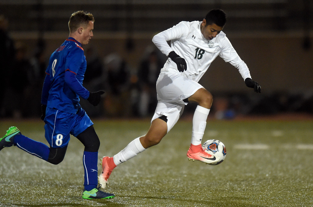 . Niwot High School\'s Jonathan Jimenez Flores moves the ball past Ethan Michel during a CHSAA 4A State Semifinal game against Centaurus on Wednesday at Legacy Stadium in Aurora. Centaurus won the game 2-0. For more photos of the game go to BoCoPreps.com Jeremy Papasso/ Staff Photographer/ Nov. 8, 2017