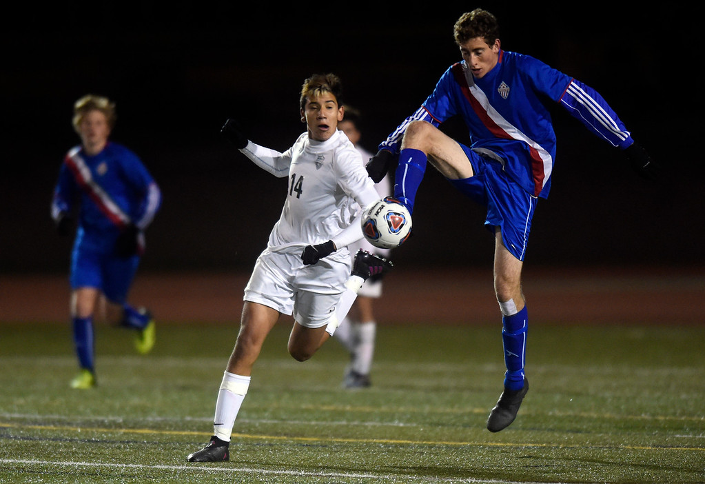 . Centaurus High School\'s Toby Rubenfeld stops a ball in front of Manuel Tapia during a CHSAA 4A State Semifinal game against Niwot on Wednesday at Legacy Stadium in Aurora. Centaurus won the game 2-0.  For more photos of the game go to BoCoPreps.com Jeremy Papasso/ Staff Photographer/ Nov. 8, 2017