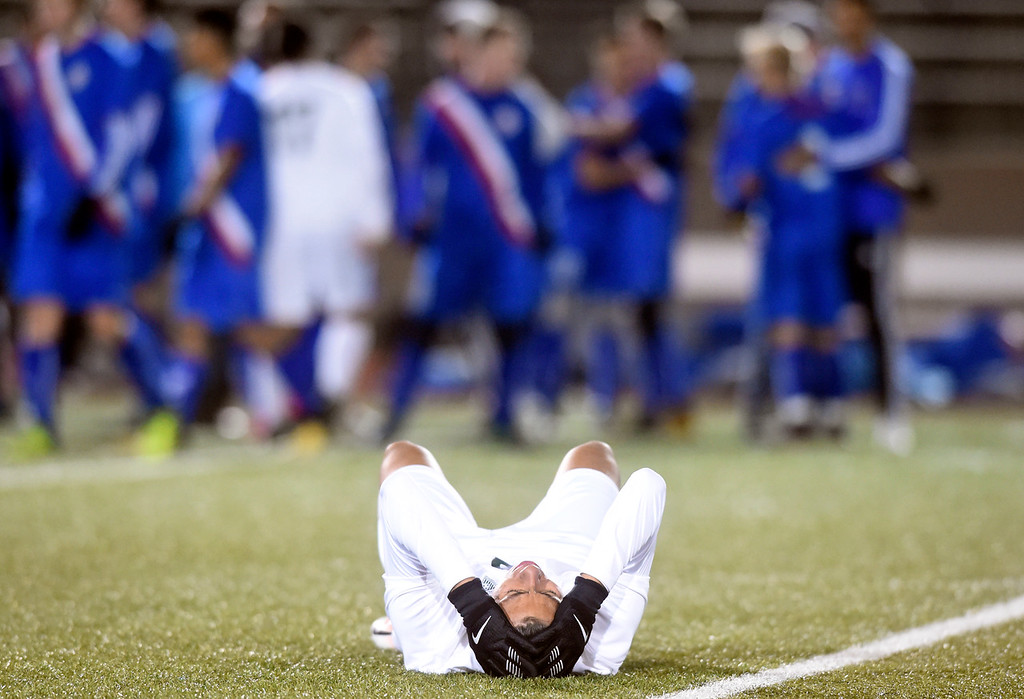 . Niwot High School\'s Jonathan Jimenez Flores shows his emotions after losing 2-0 during a CHSAA 4A State Semifinal game against Centaurus on Wednesday at Legacy Stadium in Aurora. For more photos of the game go to BoCoPreps.com Jeremy Papasso/ Staff Photographer/ Nov. 8, 2017