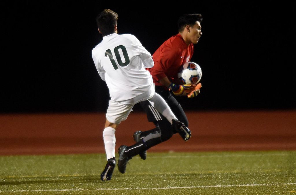 . Centaurus High School goalkeeper Rodrigo Ruiz makes a save in front of Andres Montealegre during a CHSAA 4A State Semifinal game against Niwot on Wednesday at Legacy Stadium in Aurora. Centaurus won the game 2-0. For more photos of the game go to BoCoPreps.com Jeremy Papasso/ Staff Photographer/ Nov. 8, 2017