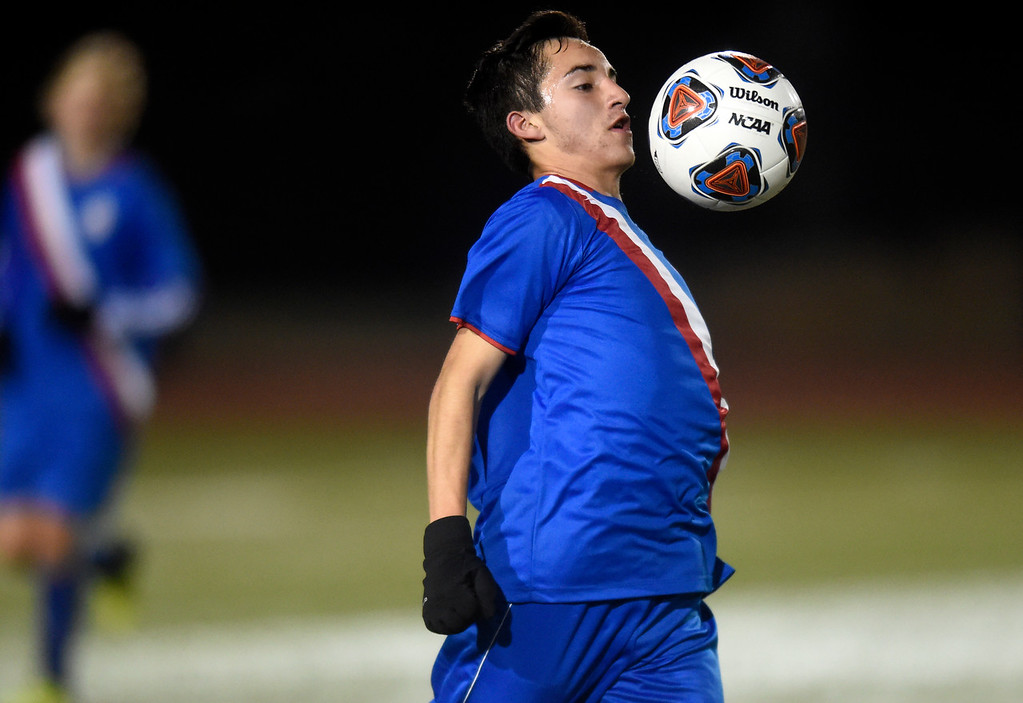 . Centaurus High School\'s Cristian Rice stops a ball with his chest during a CHSAA 4A State Semifinal game against Niwot on Wednesday at Legacy Stadium in Aurora. Centaurus won the game 2-0. For more photos of the game go to BoCoPreps.com Jeremy Papasso/ Staff Photographer/ Nov. 8, 2017