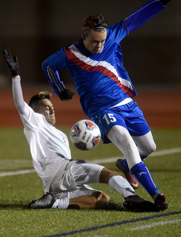. Niwot High School\'s Jason Rodriguez slide tackles C.J. Himel during a CHSAA 4A State Semifinal game against Centaurus on Wednesday at Legacy Stadium in Aurora. Centaurus won the game 2-0. For more photos of the game go to BoCoPreps.com Jeremy Papasso/ Staff Photographer/ Nov. 8, 2017