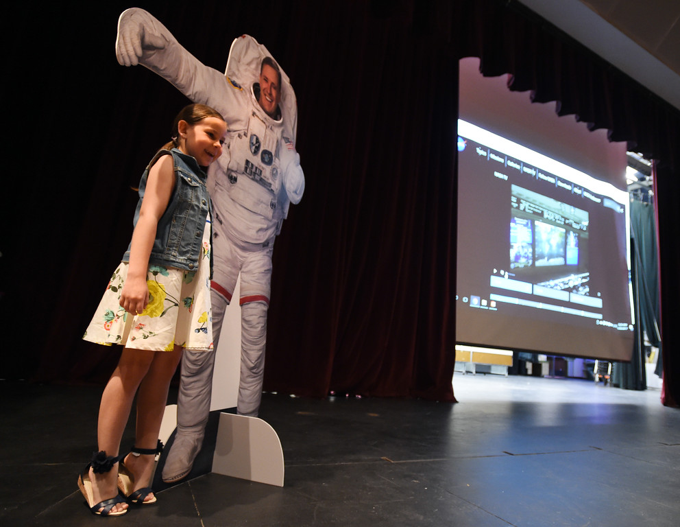 . Bella Fischer, 7, poses for a photo next to a cutout of her uncle, astronaut, Jack Fischer. 1992 Centaurus graduate astronaut, Jack Fischer, was launched to the International Space Station at 1 a.m. our time on Thursday, along with Russian crew member Fyodor Yurchikhin. Centaurus students and Fischer\'s family members were able to watch the live feed of Fischer arriving at the space station from Centaurus High School on Thursday morning. For more photos and a video, go to www.dailycamera.com. Cliff Grassmick  Staff Photographer April 20, 2017