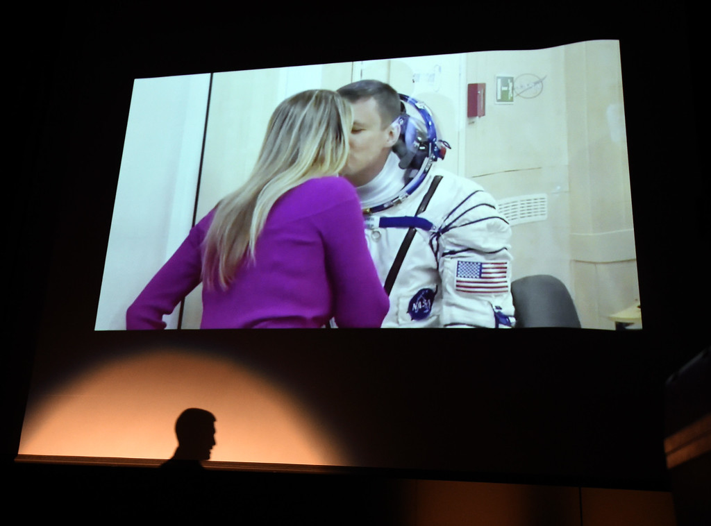 . Astronaut Jack Fischer kisses his wife, Elizabeth, before the mission Thursday morning. They are separated by glass. 1992 Centaurus graduate astronaut, Jack Fischer, was launched to the International Space Station at 1 a.m. our time on Thursday, along with Russian crew member Fyodor Yurchikhin. Centaurus students and Fischer\'s family members were able to watch the live feed of Fischer arriving at the space station from Centaurus High School on Thursday morning. For more photos and a video, go to www.dailycamera.com. Cliff Grassmick  Staff Photographer April 20, 2017