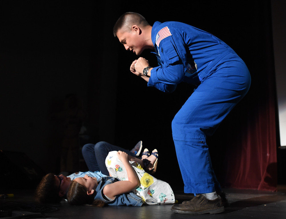 . NASA astronaut, Kjell Lingren, demonstrates how the astonauts have to sit for several hours with relative of Jack Fischer. 1992 Centaurus graduate astronaut, Jack Fischer, was launched to the International Space Station at 1 a.m. our time on Thursday, along with Russian crew member Fyodor Yurchikhin. Centaurus students and Fischer\'s family members were able to watch the live feed of Fischer arriving at the space station from Centaurus High School on Thursday morning. For more photos and a video, go to www.dailycamera.com. Cliff Grassmick  Staff Photographer April 20, 2017