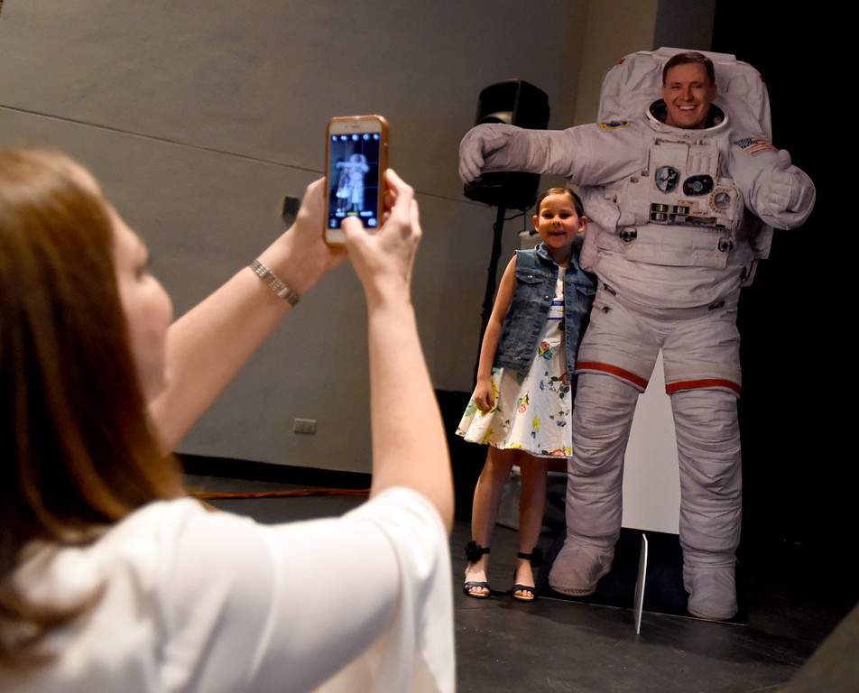 . Geri Fischer, sister-in-law- to Astronaut Jack Fischer, photographers her daughter, Bella, 7, next to a cutout of Jack. 1992 Centaurus graduate astronaut, Jack Fischer, was launched to the International Space Station at 1 a.m. our time on Thursday, along with Russian crew member Fyodor Yurchikhin. Centaurus students and Fischer\'s family members were able to watch the live feed of Fischer arriving at the space station from Centaurus High School on Thursday morning. For more photos and a video, go to www.dailycamera.com. Cliff Grassmick  Staff Photographer April 20, 2017