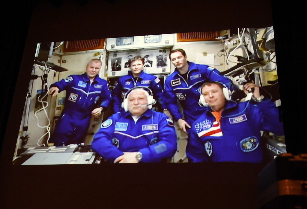 . Jack Fischer, bottom right, and the other four astronauts take to family and the press back on Earth. 1992 Centaurus graduate astronaut, Jack Fischer, was launched to the International Space Station at 1 a.m. our time on Thursday, along with Russian crew member Fyodor Yurchikhin. Centaurus students and Fischer\'s family members were able to watch the live feed of Fischer arriving at the space station from Centaurus High School on Thursday morning. For more photos and a video, go to www.dailycamera.com. Cliff Grassmick  Staff Photographer April 20, 2017