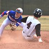Silver Creek's Charlie Jackson slides in just ahead of tag by Centaurus infielder jack Battistelli while stealing second base on Tuesday, March 22, at Silver Creek High School.
