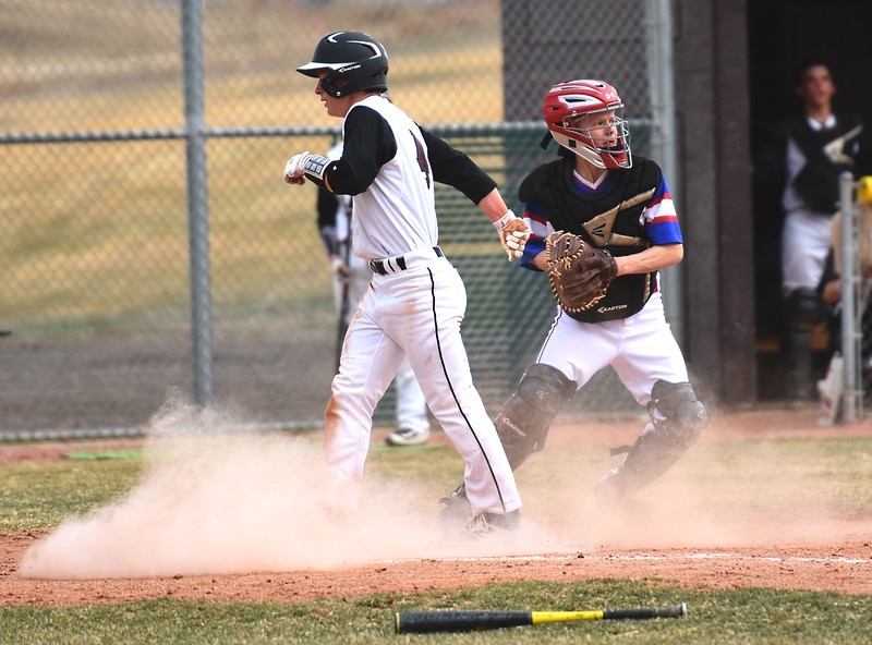Silver Creek's Charlie Jackson crosses home plate during the Raptors' 7-1 win over Centaurus on Thursday, March 22, at Silver Creek High School.