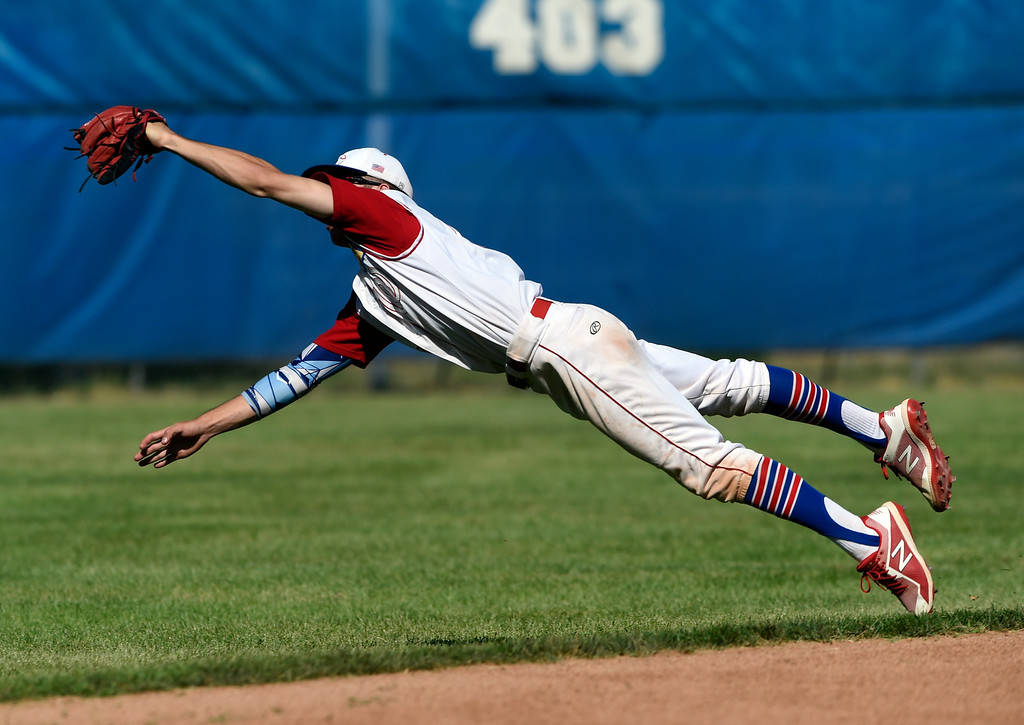 . Centaurus High School\'s Nick VanTassel makes a diving catch at short-stop during a NIT tournament game against the Impact on Wednesday at Centaurus High School in Lafayette. More photos: BoCoPreps.com Jeremy Papasso/ Staff Photographer 07/11/2018