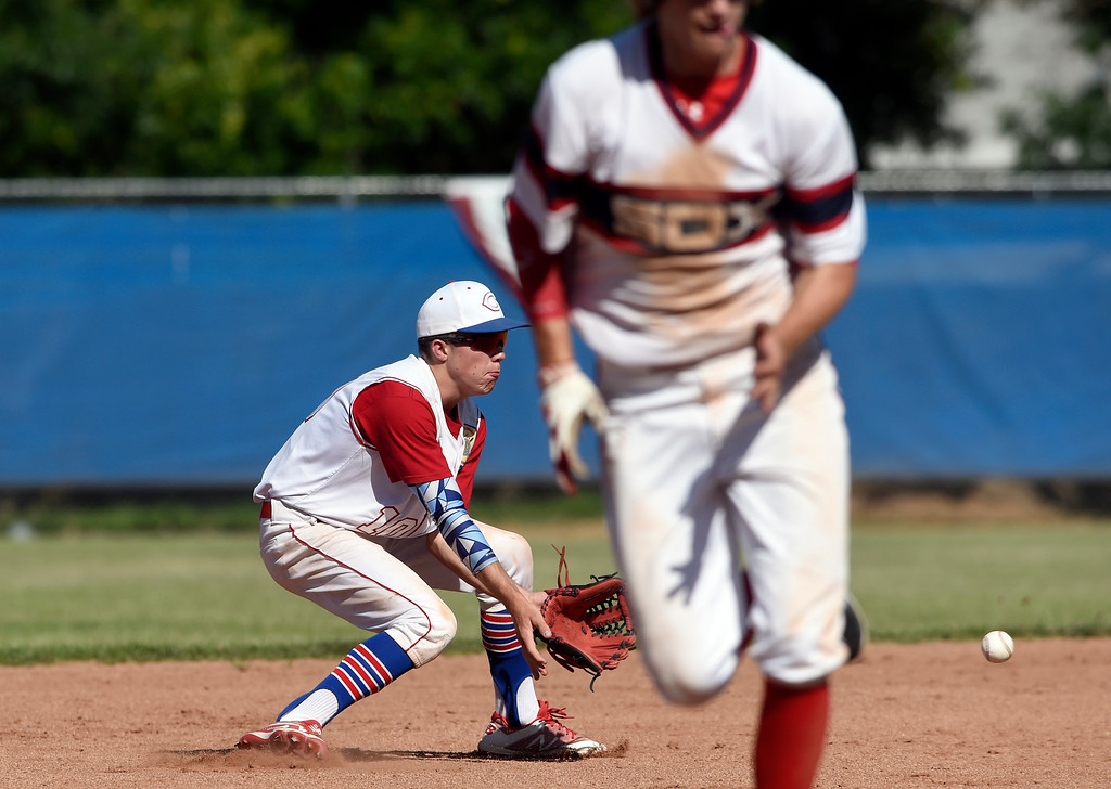 . Centaurus High School\'s Nick VanTassel makes a stop at short-stop for an out at first base during a NIT tournament game against the Impact on Wednesday at Centaurus High School in Lafayette. More photos: BoCoPreps.com Jeremy Papasso/ Staff Photographer 07/11/2018