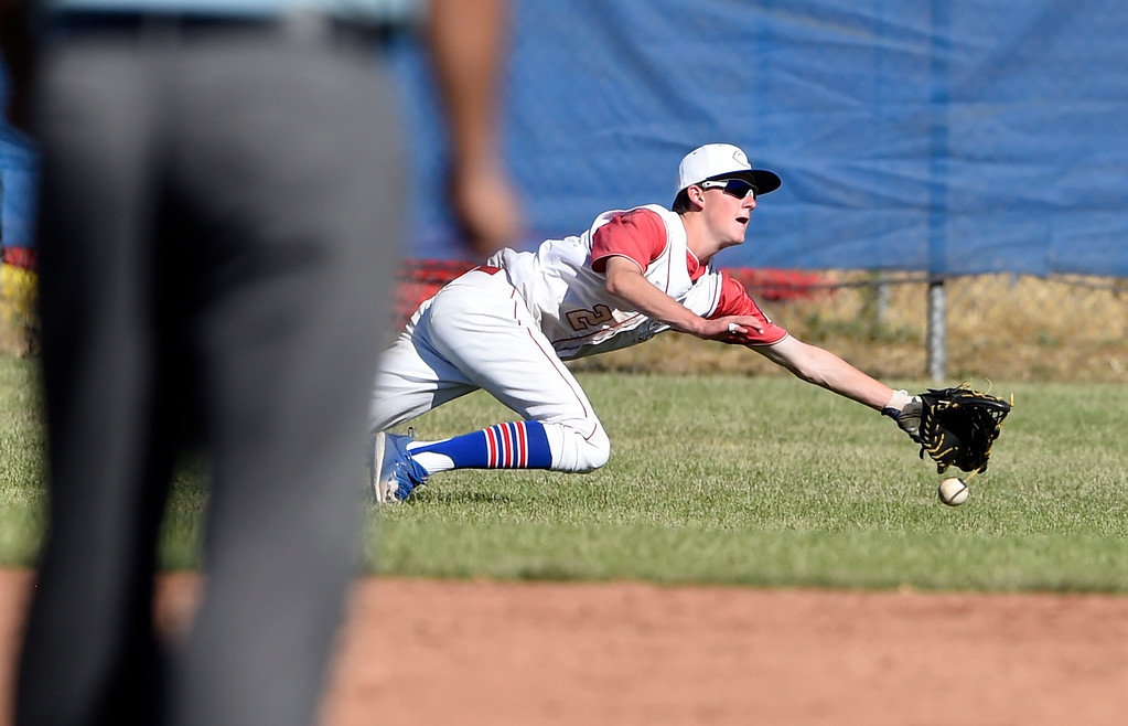 . Centaurus High School\'s Brendon Day misses a diving catch in the outfield during a NIT tournament game against the Impact on Wednesday at Centaurus High School in Lafayette. More photos: BoCoPreps.com Jeremy Papasso/ Staff Photographer 07/11/2018