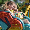 Sisters Joey Sobak, 13, and Alyxa Sobak, 11, of Shelby Township, enjoy the Sizzler amusement ride at Center Line's Independence Festival.  Ray Skowronek--The Macomb Daily