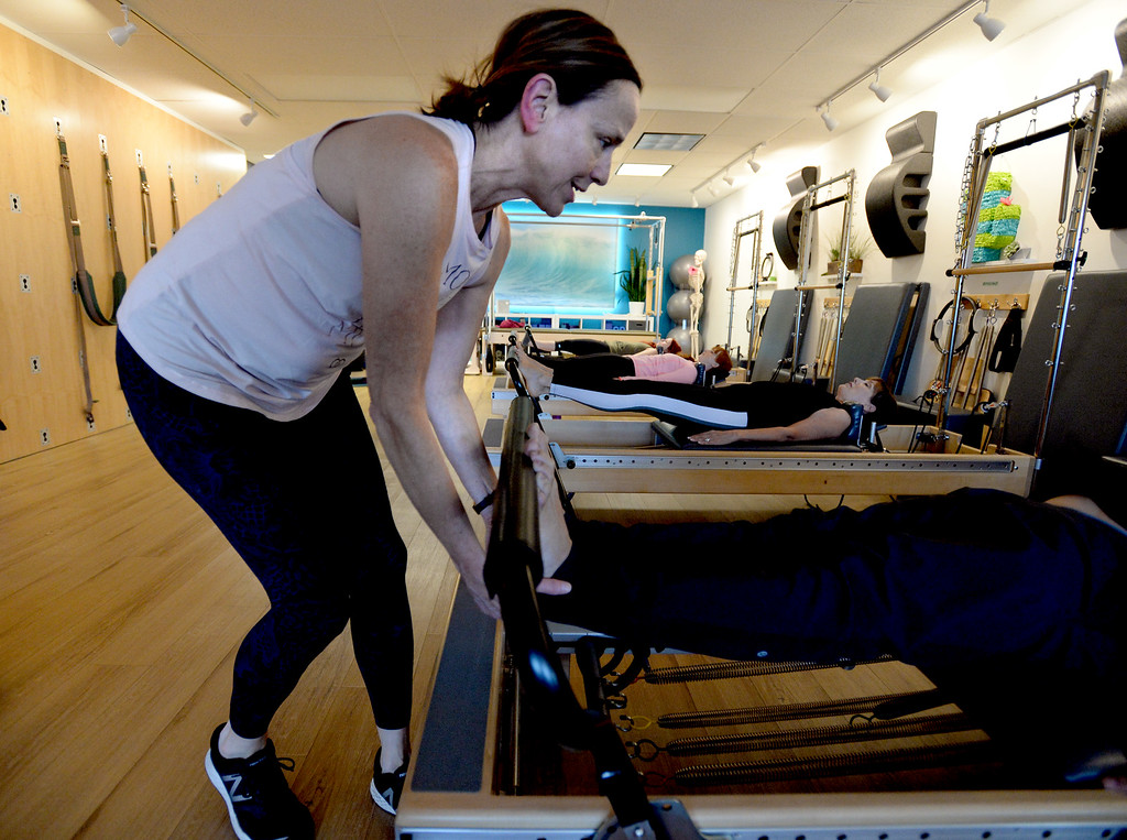 . LOUISVILLE, CO: November 6: Instructor, Tracy Bodder, works with one of the clients on Tuesday. Center Stream Pilates, in Louisville, is the Workout of Week. (Photo by Cliff Grassmick/Staff Photographer)